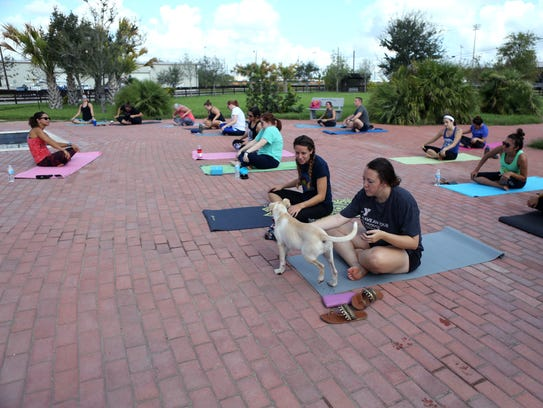 Residents participated in a DOGA class, or yoga with
