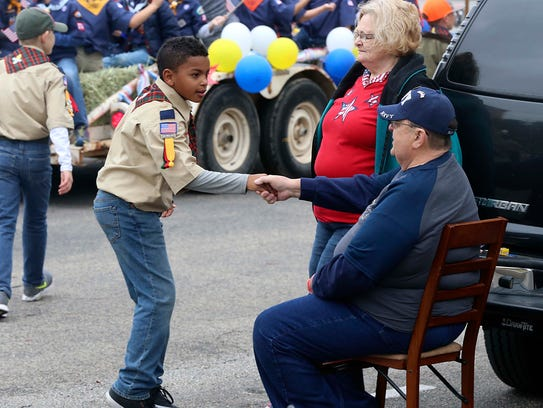 "A member of the San Angelo Boy Scout Troop 374 shakes hands with a veteran during the 14th annual ""Salutes American Heroes"" parade  Nov. 11, 2017. The Boy Scouts need volunteers to assist with various functions throughout the year."