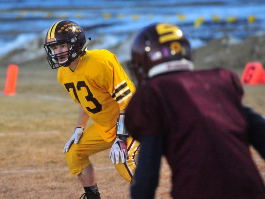 Shelby's Zach Torgerson goes through defensive drills
