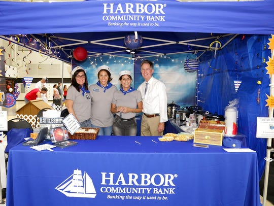 The crew of Harbor Community Bank's  Battleship booth
