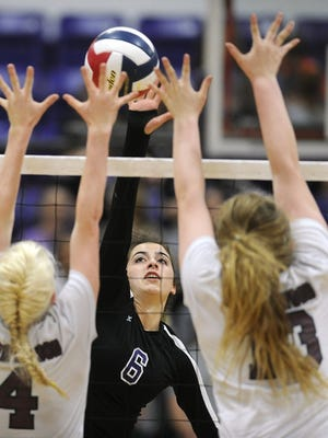 Thomas Metthe/Reporter-News Wylie's Gracie McCaslin (6) spikes the ball between Brownwood's Bailey Randle (4) and Torrey Miler (13) Brownwood's during the second game of the Lady Bulldogs' win on Tuesday, Oct. 25, 2016, at Wylie High School.