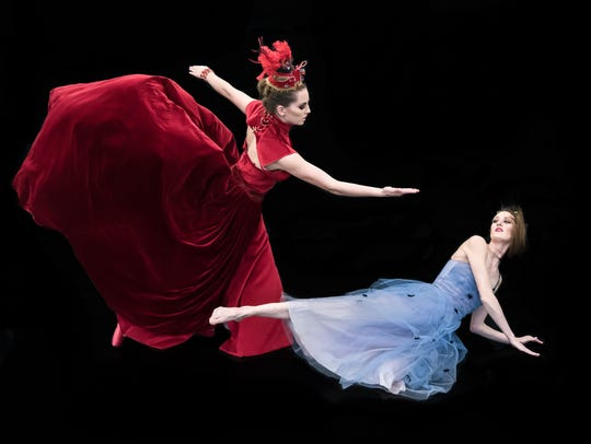 "Micah McKee dances as the Red Queen, and Harper Addison is Alice in GO! Contemporary Dance Works' ""Alice."""