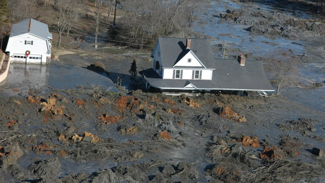 A home is shown Dec. 22, 2008, near the TVA Kingston Fossil Plant in Roane County after the failure of a dike that unleashed more than 1.1 billion gallons of toxic coal ash slurry.