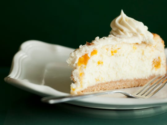Finish your meal with a piece of tangy coconut-mango cheesecake.