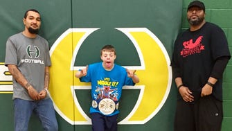 Hillsboro High School freshman Steven Mast, center, with coaches who are training him, Tyler Anderson, left, and Jerry Vanderpool.