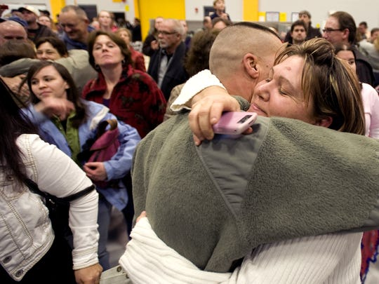 SSgt. Jared Daigneault of St. Johnsbury is greeted by his family as 100 members of the Vermont National Guard 86th Infantry Brigade Combat Team returned home from Afghanistan in 2010.