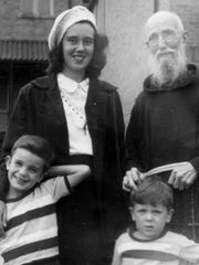 Father Solanus Casey is shown in 1948 with his great niece Anne Herkenrath and her cousins Dean Conley and Jimmy Conley.