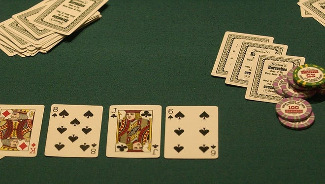 The chips and cards for a game of Texas Hold 'Em are on the table during the opening day of the World Series of Poker in downtown Las Vegas in this 2003 photo.