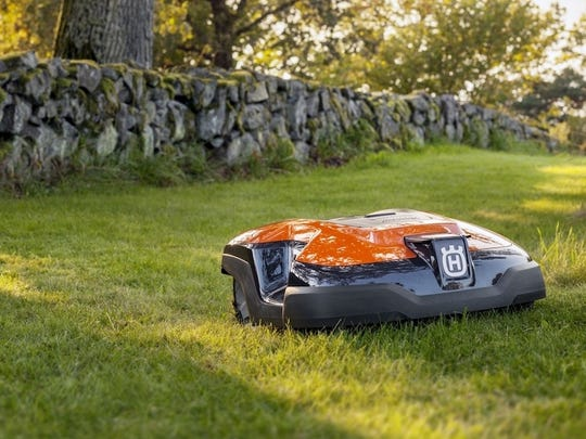 Let a robot cut your grass for you while you sip a