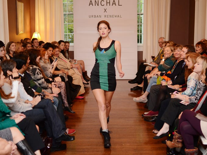 Model Brooke Schmidt on the runway at the Anchal Urban Renewal Fashion Show at the Peterson-Dumesnil House Wednesday evening. October 17, 2013.