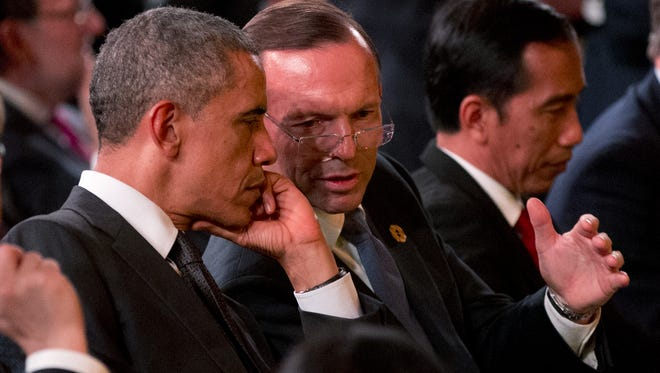President Barack Obama speaks with Prime Minister of Australia Tony Abbott, right, at the G-20 summit Nov. 15, 2014, in Brisbane, Australia.
