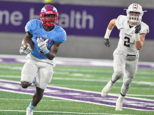 Hirschi running back Daimarqua Foster runs away from the Brownwood defense for a touchdown during the Huskies 44-34 win in a Region I-4A bi-district playoff Friday at Abilene Christian University's Wildcat Stadium.