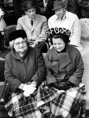Charlie Gehringer, top left, and Josephine Gehringer, bottom right, attend a Tigers game in this undated photo.