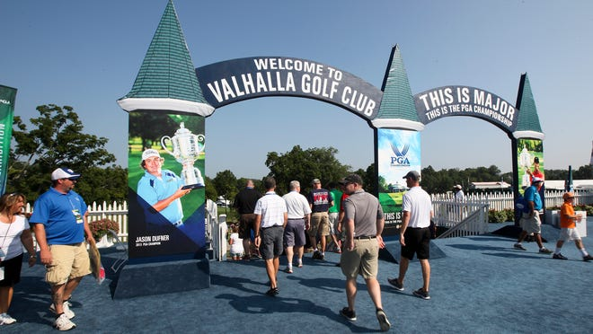A steady stream of golfers make their way into Valhalla for the opening round of practice for the 96th PGA Championship. August 4, 2014