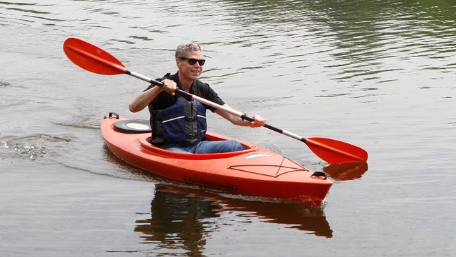 City of White Plains Mayor Tom Roach kayaks on Silver Lake at Liberty Park in North White Plains on Friday, May 27, 2016.