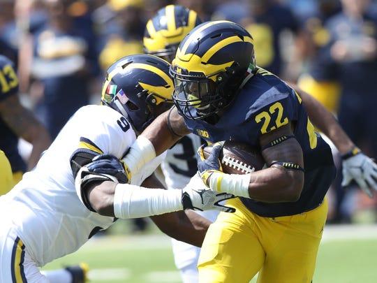 Michigan running back Karan Higdon runs the ball in the spring game Saturday, April 15, 2017 at Michigan Stadium in Ann Arbor.