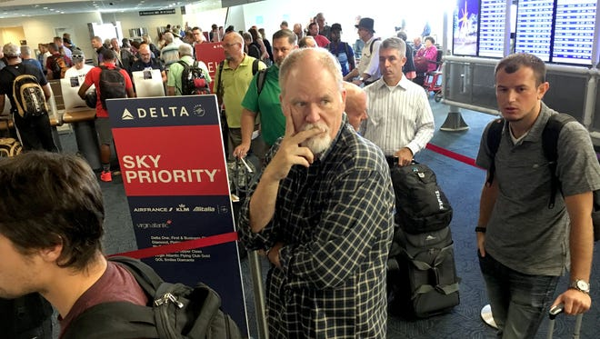 Passengers wait in the Delta Airlines ticketing area at Mitchell International Airport in Milwaukee, to check bags and get boarding passes.
