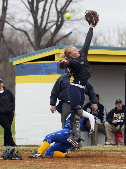 Northern Lebanon's Kacey Smoot is safe at home as a ball from the outfield is thrown over the head of Elco catcher Beth Hess.
