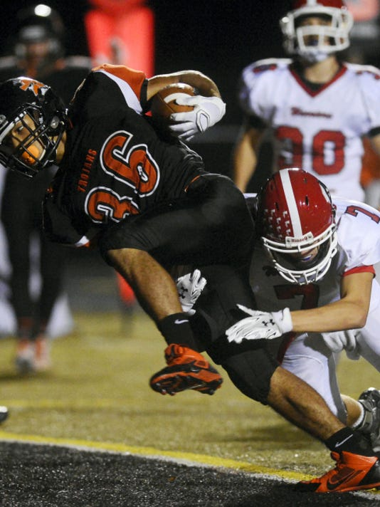 York Suburban's Jadon Haynes drives through Susquehannock's Chase Summers into the end zone for a touchdown during a Trojans' victory earlier this month. York Suburban is 3-0 in YAIAA Division II play, tied with Dover for first place.