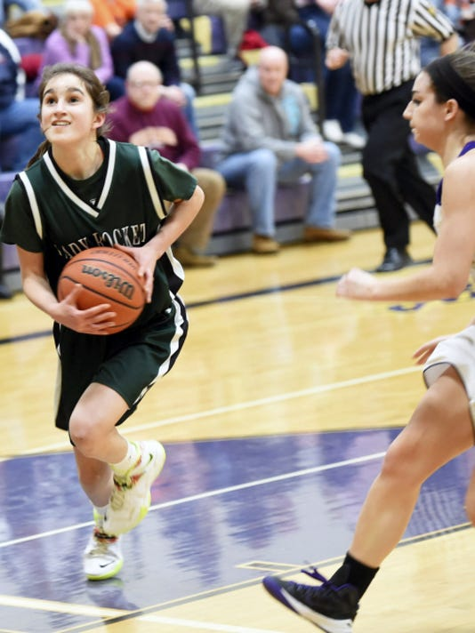 James Buchanan's Rachel Martin (23) drives to the basket against Boiling Springs on Friday. Martin scored seven points in the fourth quarter to propel the Rockets to a 40-33 win in a District 3 Class AAA play-in game.