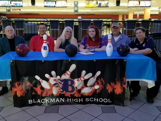 Former Blackman bowling standout Erika Sisk recently signed to play for Kentucky Wesleyan. Pictured, from left, are coach Sam Dillard, coach Mike Sealy, mother Lorie Sisk, Erika Sisk, father Joey Sisk and Blackman coach Michele Giacobbi.