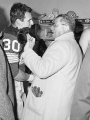 Fullback Chuck Mercein, cut by the Giants late in the '67 season and picked up by the Packers, is congratulated by Vince Lombardi after playing a key role in the Ice Bowl.