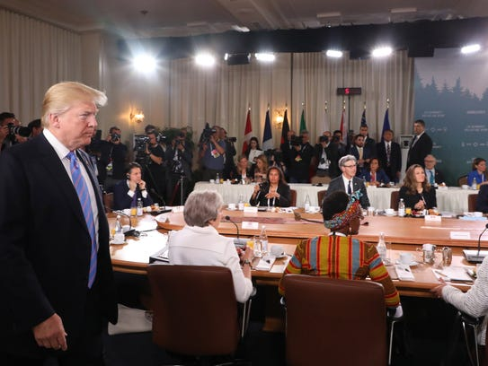 epa06796230 US President Donald J. Trump (L) arrives to attend the G7 and Gender Equality Advisory Council Breakfast at the G7 summit in Charlevoix in Canada 09 June 2018. The G7 Summit runs from 08 to 09 June in Charlevoix, Canada.