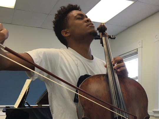 Nineteen-year-old Ismael Guerrero received a full scholarship to attend Heifetz International Music Institute's summer program. From Cuba, Guerrero has been playing the cello since he was eight years old. In this photo, he is taking a master class taught by Frans Helmerson at Mary Baldwin University in Staunton on Tuesday, July 18, 2017.