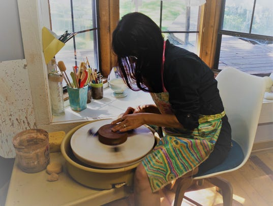 Denise Puglia Henry, Ruidoso artist, working at the potter wheel.