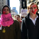 Occupy Wall Street participants take part in a protest to mark the movement's second anniversary in New York, Sept. 17, 2013.