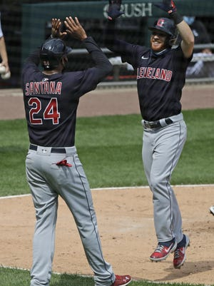 The Cleveland Indians' Jordan Luplow, right, celebrates with Domingo Santana after hitting a two-run home run against the Chicago White Sox during the fourth inning in Chicago on Saturday.