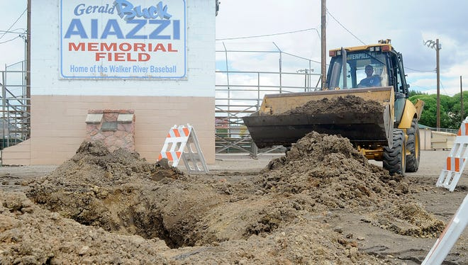 Yerington Public Works Director Jay Flakus uses a backhoe to fill in dirt over a recently fixed water line.