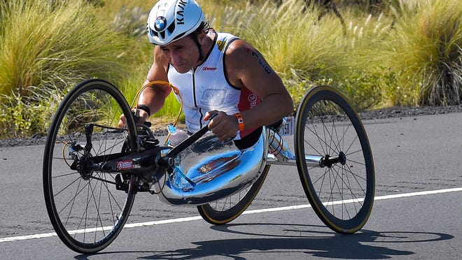FILE - In this Saturday, Oct. 10, 2015 file photo, Alex Zanardi, of Italy, rides during the cycling portion of the Ironman World Championship Triathlon, in Kailua-Kona, Hawaii. Race car driver turned Paralympic champion Alex Zanardi has been seriously injured again. Police tell The Associated Press that Zanardi was transported by helicopter to a hospital in Siena following a road accident near the Tuscan town of Pienza during a national race for Paralympic athletes on handbikes. The 53-year-old Zanardi had both of his legs amputated following a horrific crash during a 2001 CART race in Germany. He was a two-time CART champion.