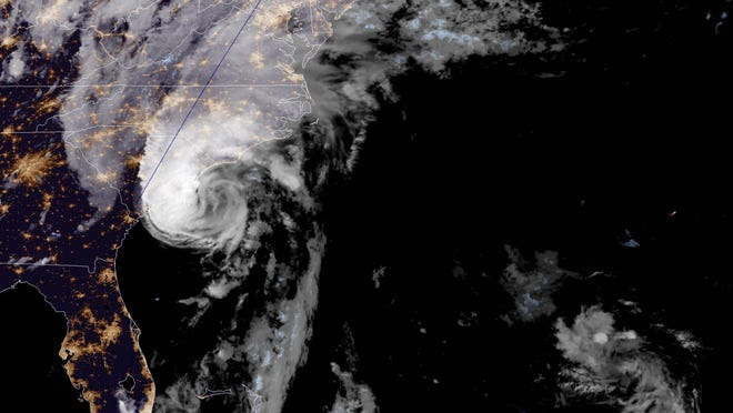 This GOES-16, GeoColor satellite image taken Monday at about 8:30 p.m. shows Hurricane Isaias moving up the east coast from Florida.
