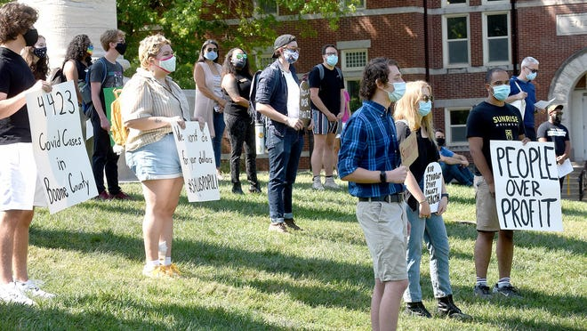 About three dozen protesters chanted slogans and denounced the University of Missouri's policy of protecting students' health during the COVID-19 pandemic on Friday in front of the columns at Jesse Hall.