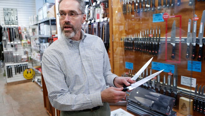 Owner Larry Oates shows off a selection of Wüsthof knives at Kitchen Art, 1550 Win Hentschel Blvd. in West Lafayette. Kitchen Art offers a selection of high-quality kitchen and eating utensils.