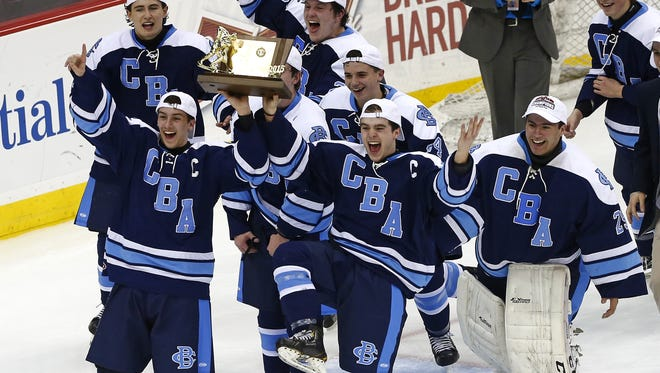 Rich Schultz/Correspondent CBA?s Greg Malafronte (left) and Conor Tierney  hold the championship trophy as they skate with their team after beating Delbarton  to win the NJSIAA Non-Public title on Monday. Greg Malafronte #18 and Conor Tierney #19 of CBA hold the championship trophy as they skate with their team after defeating Delbarton 4-3 in overtime during the Non-Public state hockey final at Prudential Center in Newark, N.J. on Monday, March 9, 2015. Photo by Rich Schultz/ Asbury Park Press