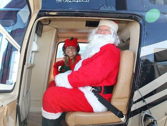 636464313956439611-santa-helicopter.jpg