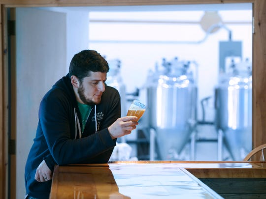 Tony Moringello, owner of Noble Shepherd Craft Brewing, holds a Walter's Original IPA in Bristol, Ontario County.