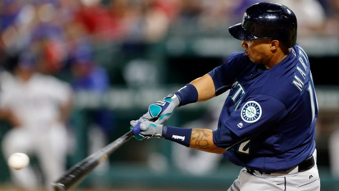 Seattle Mariners' Leonys Martin connects for a run-scoring double to right off a pitch from Texas Rangers relief pitcher Tony Barnette that scored Seth Smith in the seventh inning of a baseball game, Tuesday, April 5, 2016, in Arlington, Texas. Martin reached third on a throwing error by Rangers right fielder Shin-Soo Choo. (AP Photo/Jim Cowsert)