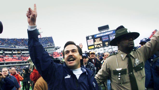 Tennessee Titans coach Jeff Fisher, left, celebrates with the fans after his Titans 22-16 victory over the Buffalo Bills in the AFC wildcard playoff game at Adelphia Coliseum Jan. 8, 2000.
