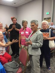 State Senate candidate Joy Silver speaks with supporters