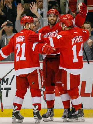 Red Wings forward RIley Sheahan, center, celebrates with Tomas Tatar and Gustav Nyquist after scoring a goal in the second period of the Wings' 3-2 win over the Sabres Monday at Joe Louis Arena.