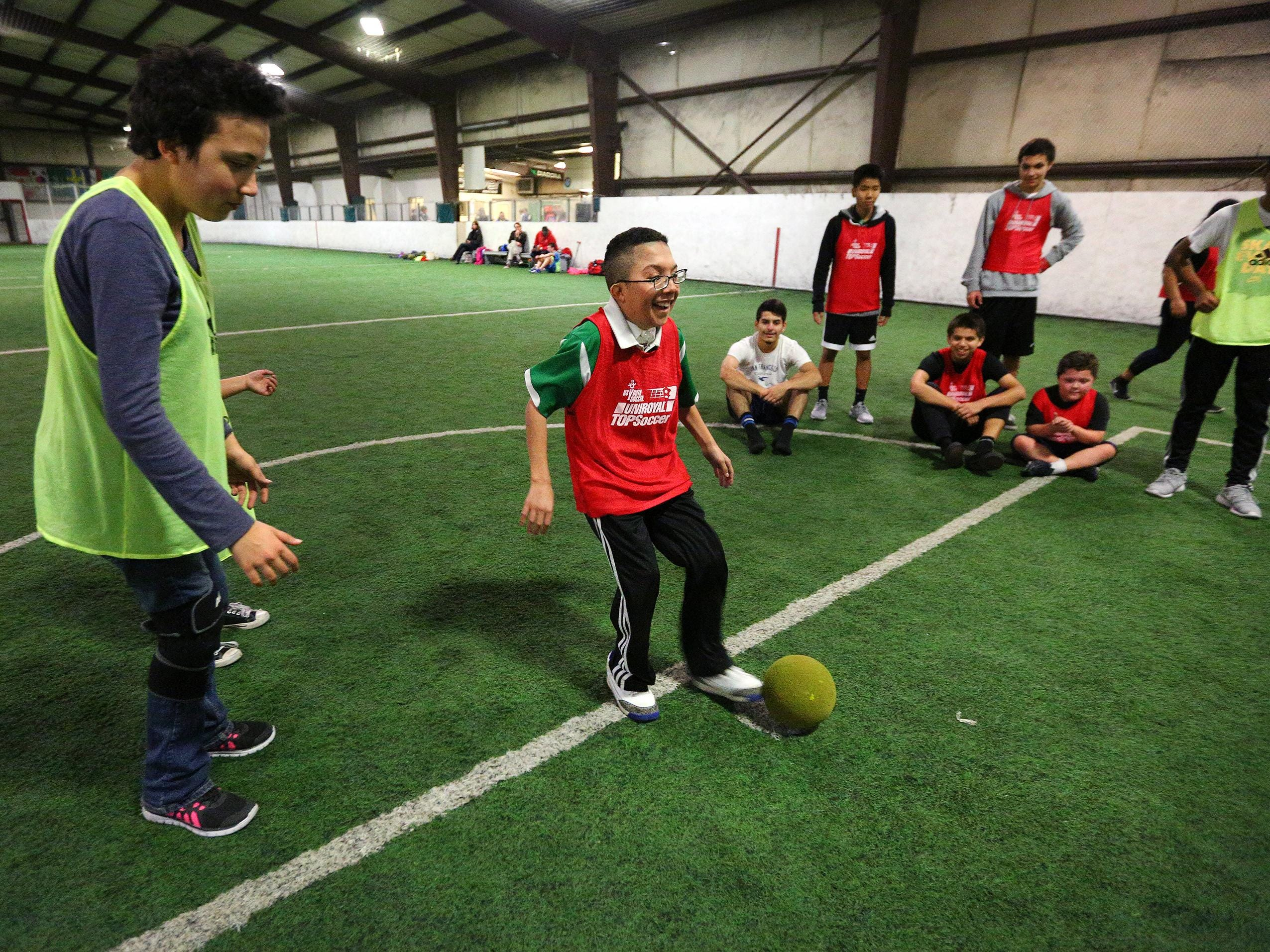 Corazon Barocio, 17, scores the game-winning goal during a youth soccer program with North Salem High School's boys soccer team, Wednesday, Nov. 18 at Salem Indoor Soccer Center in Salem.