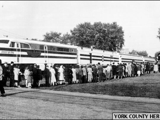 Queue of Yorkers waiting to visit York's Car of Documents