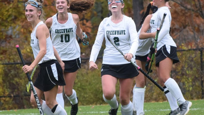 Dover High School players, including Savanah Connor (2) and Meghan Fitzgerald (10), celebrate the winning goal in their overtime win against Timberlane in the Division I field hockey playoffs on Oct. 22, 2019, in Dover. The fate of the fall sports season in 2020 is not yet known.