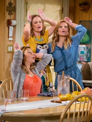 Jodie Sweetin, left, Andrea Barber and Candace Cameron Bure star in Netflix's 'Fuller House.'