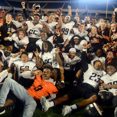 The Cocoa Tigers celebrate their Class 4A state football