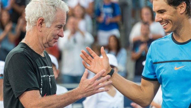 Spanish tennis player Rafael Nadal (R) and former US tennis player John McEnroe (L) shake hands after an exhibition tennis match held at 'Rafa Nadal Sports Centre' in Manacor, Balearic Islands, Spain, 25 September 2016.