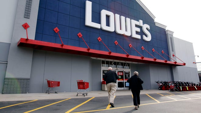 Customers walk toward the Lowe's store in Saugus, Mass.